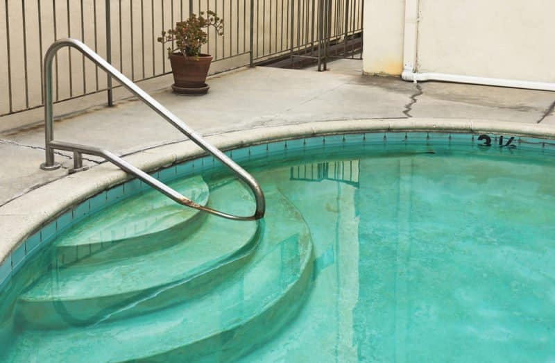 Greenish stains on the pool walls and floors may be an indication of too much copper in your pool water.